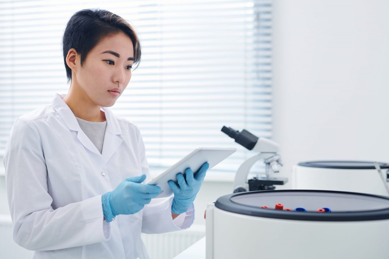 modern-researcher-viewing-results-on-tablet-ZPTFR6D-scaled-1280x854.jpg